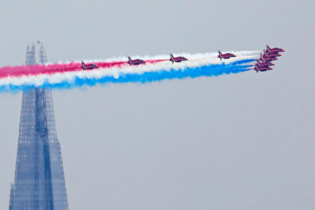 TOPSHOT - Members of the British Royal Air Force Aerobatic Team, the Red Arrows, fly in formation past The Shard skyscraper, as they perform a fly-past above Buckingham Place during the Queen's Birthday Parade, 'Trooping the Colour', in London on June 17, 2017. The ceremony of Trooping the Colour is believed to have first been performed during the reign of King Charles II. In 1748, it was decided that the parade would be used to mark the official birthday of the Sovereign. More than 600 guardsmen and cavalry make up the parade, a celebration of the Sovereign's official birthday, although the Queen's actual birthday is on 21 April. / AFP PHOTO / Tolga AKMEN (Photo credit should read TOLGA AKMEN/AFP/Getty Images)